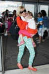 """Rielle Hunter makes her way home with daughter Quinn after making the rounds in New York to promote her book """"What Really Happened: John Edwards, Our Daughter and Me"""""""