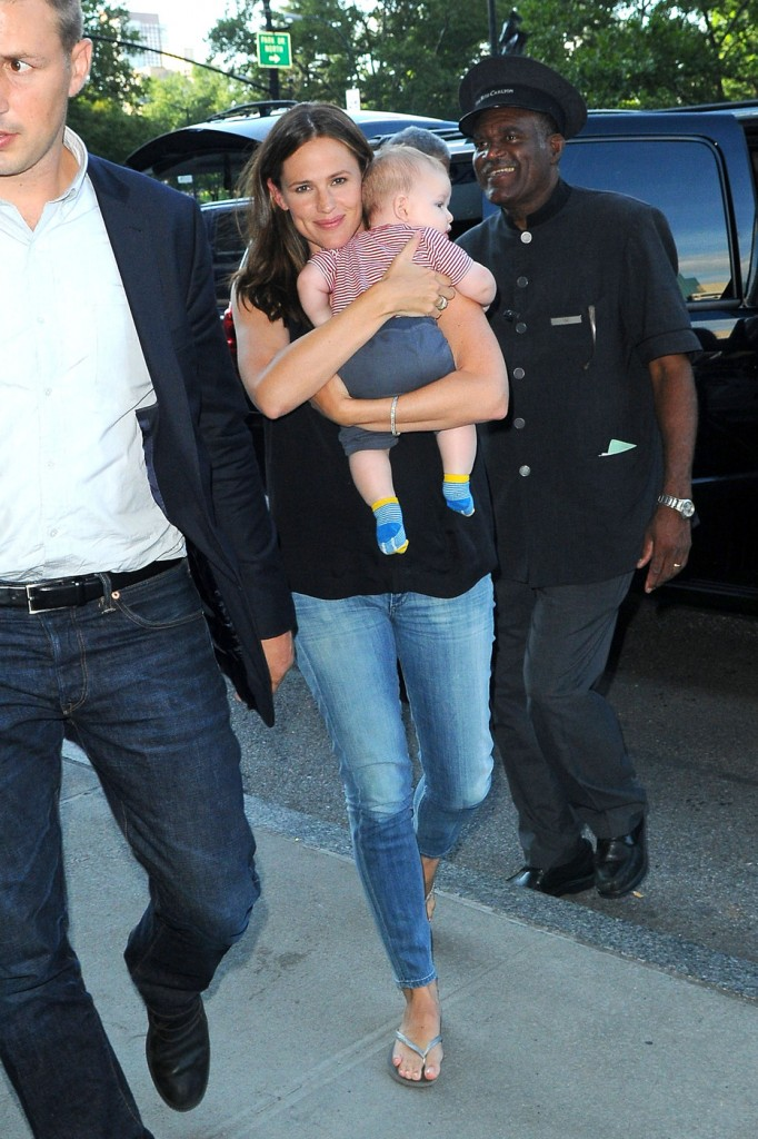Jennifer Garner holds her adorable son Samuel tight as they arrive at a New York City hotel