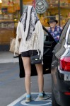 Amanda Bynes covers up in an attempt to not let the photographers see her grab an afternoon cupcake in West Hollywood