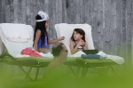 Katie Holmes and Suri Cruise wear bikinis as they spend the afternoon poolside in Miami
