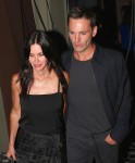Courteney Cox shows off her engagement ring as she and her fiance Johnny McDaid leave Craig's in West Hollywood
