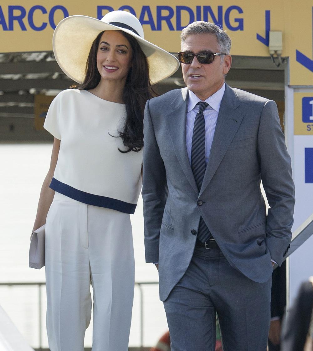 FFN_Clooney_Alamuddin_airport_SGP_092914_51543777