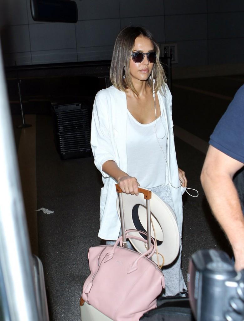 Jessica Alba makes her way through LAX