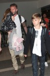 David Beckham looks tan as he makes his way through LAX with his children