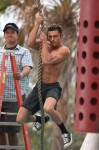 Zac Efron shows off his ripped body as he gets shirtless for 'Baywatch' in Miami