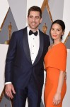 Actress Olivia Munn (R) and NFL player Aaron Rodgers attend the 88th Annual Academy Awards at Hollywood & Highland Center in Hollywood, California