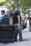 Joel Mchale entering his hotel in New York