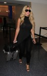 Kim Zolciak arrives for a flight with her daughters at LAX