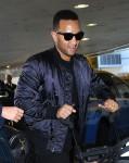 John Legend And Chrissy Teigen Depart LAX