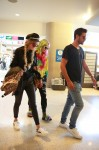 Rumored hot new couple, Scott Disick and Bella Thorne with Bella's sister Dani rush through LAX airport on their way to Cannes