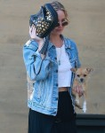 Jennifer Lawrence gets shy and covers her face as she heads to Nobu