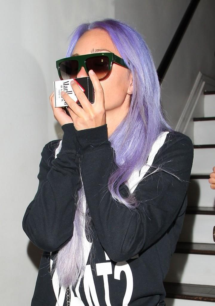Troubled star Amanda Bynes spotted leaving Nine Zero One salon sporting new purple hair