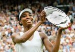 First time Wimbledon champion Garbine Muguruza spoilt Venus Williams' day by winning in Straight sets Williams is seen smiling with the runners up trophy during the Women's final match between Garbine Muguruza and Venus Williams on Centre Court on day twelve of the Wimbledon Lawn Tennis Championships