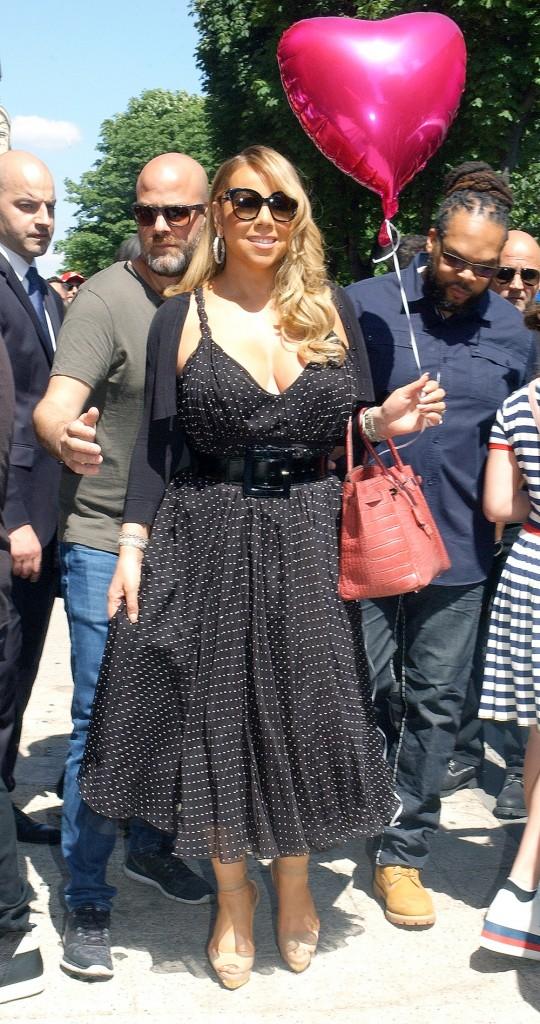 Mariah Carey leaving the Plaza Athénée Hotel