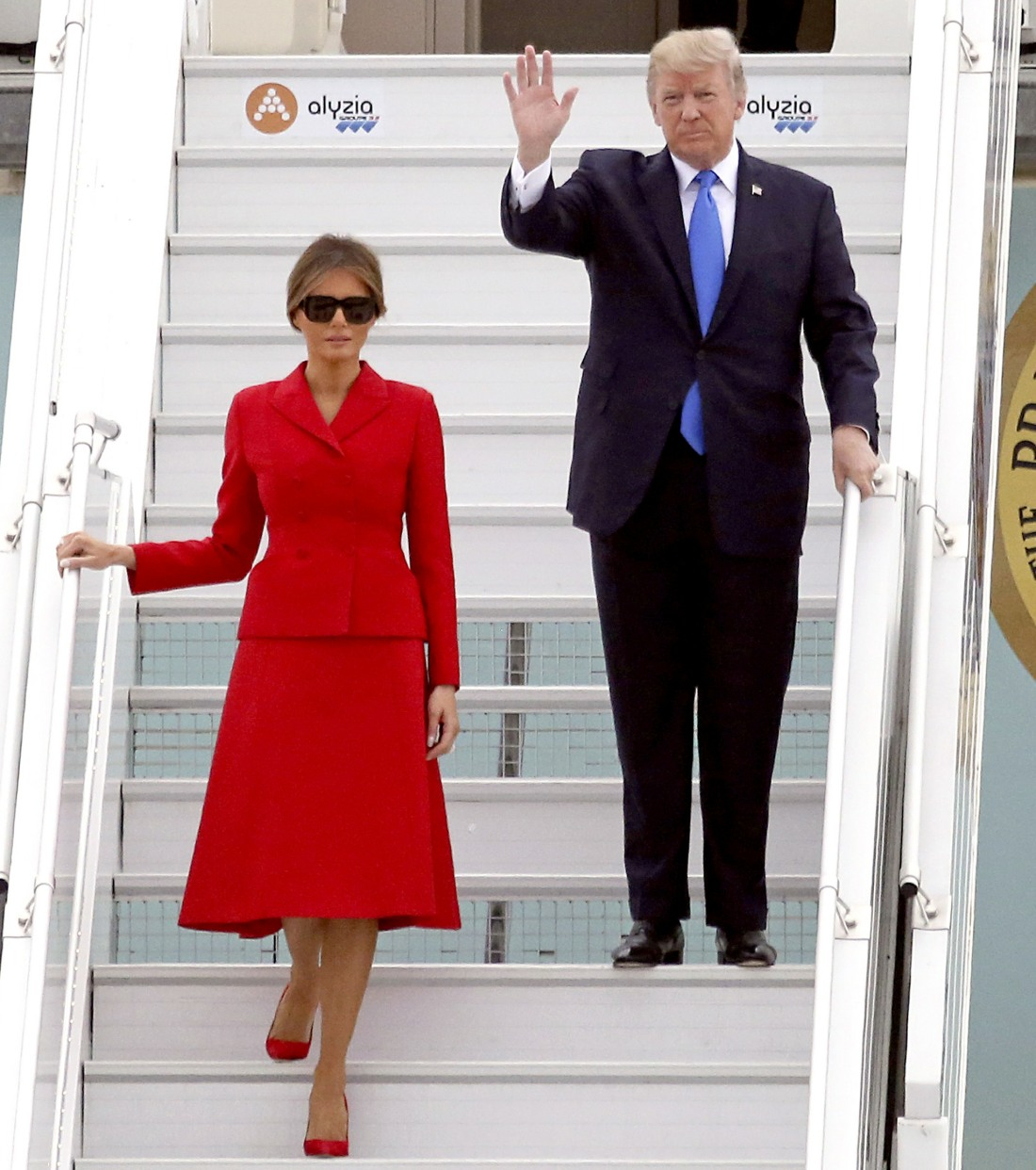 US President Donald Trump and his wife Melania Trump arrive at Paris' Orly Airport