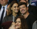 Robin Thicke and April Love Geary watch PSG
