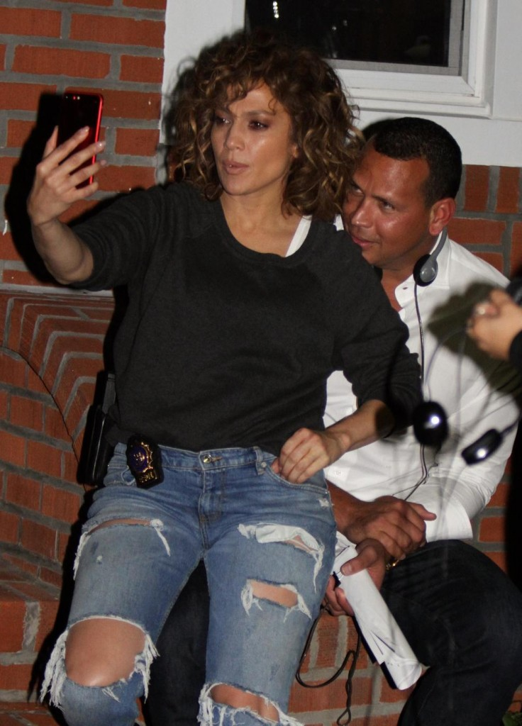 Alex Rodriguez and Jennifer Lopez take selfies during a break in filming at the Shades of Blue set in Richmond Hill, Queens