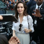Angelina Jolie signs autographs as she arrives for her in-conversation appearance at the Toronto International Film Festival