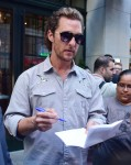 Matthew McConaughey signs autographs for fans as he leaves a Dark Tower press junket