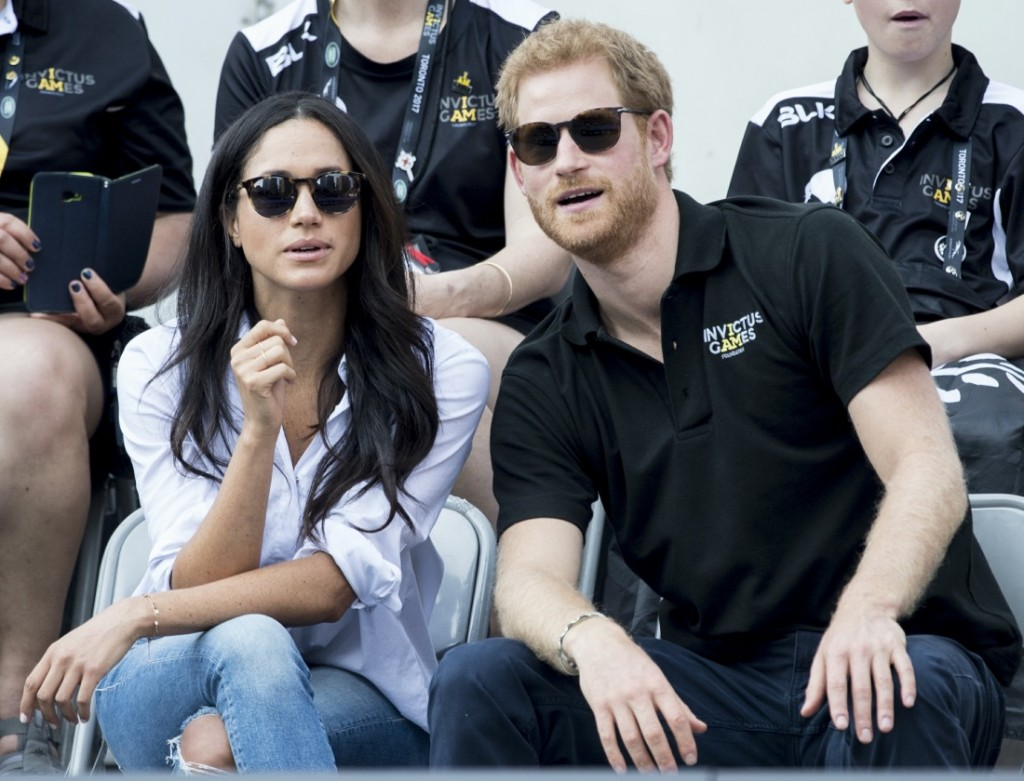 Prince Harry and his girlfriend Meghan Markle watch a wheelchair tennis match as part of the Invictus Games in Toronto