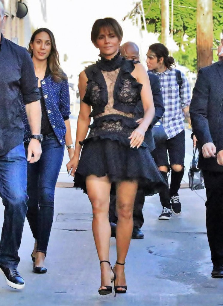 Halle Berry signs autographs for waiting fans as she arrives for her appearance on Jimmy Kimmel Live!