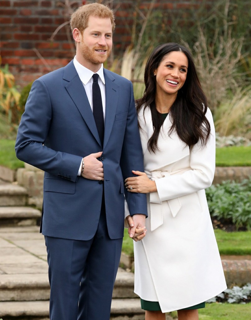 Prince Harry and Meghan Markle at a photocall to officially announce their engagement at the Sunken Garden at Kensington Palace