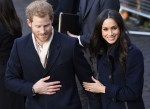 Prince Harry and Meghan Markle greet fans while visiting Nottingham