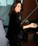 Angelina Jolie flashes her pretty smile as she arrives at an office building in New York