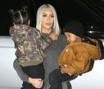 Kim Kardashian helps son Saint ice skate as she hits the rink with daughter North