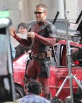 Ryan Reynolds takes time out of filming Deadpool 2 to come over and greet some fans while swinging his sword around for them