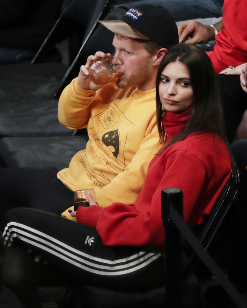 Emily Ratajkowski enjoys a drink and a game with a kiss happy mystery guy