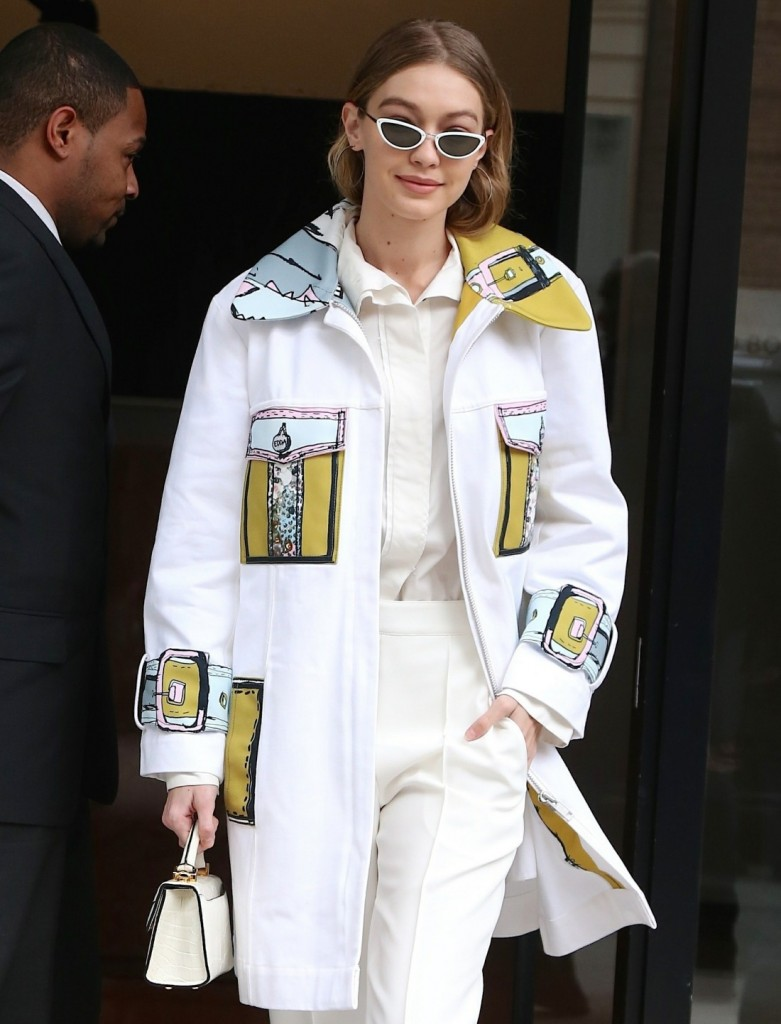 Gigi Hadid is all smiles as she leaves her apartment