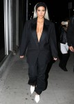 Kim Kardashian shows major cleavage in an oversized blazer at the Create & Cultivate Conference