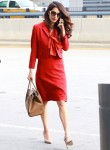 Amal Clooney is business chic while trotting through JFK airport on her phone