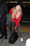 Hilary Duffand her boyfriendMatthew Komaarrive at Los Angeles International (LAX) Airport
