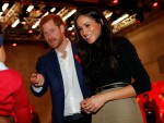 Britain's Prince Harry and his fiancee US actress Meghan Markle greet a well-wisher as they tour the Terrence Higgins Trust World AIDS Day charity fair at Nottingham Contemporary in Nottingham.