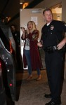 Tori Spelling and Dean McDermott are escorted out of Tarzana's Black Bear Diner by the LAPD after cops were called for a disturbance between the couple as they had dinner with their kids