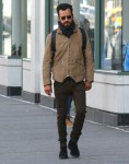 Newly-single Justin Theroux goes for a solo stroll through sunny downtown Manhattan without his wedding ring