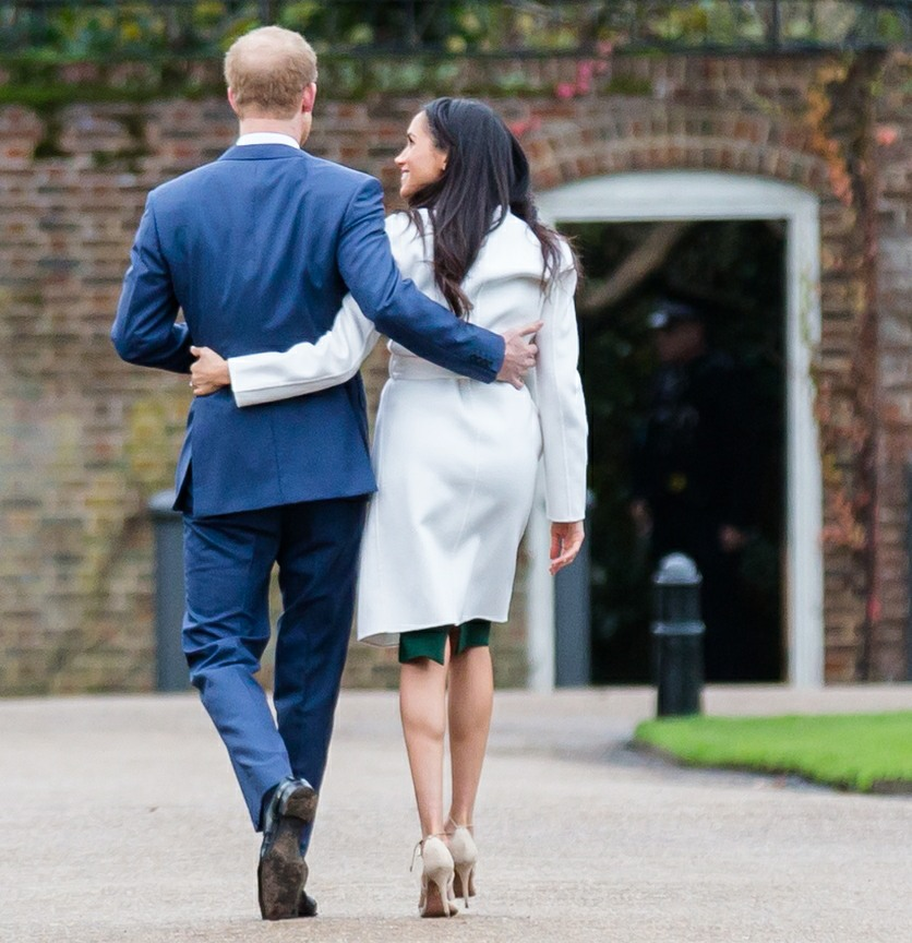 Prince Harry and Meghan Markle arrive at a photocall to officially announce their engagement at the Sunken Garden at Kensington Palace
