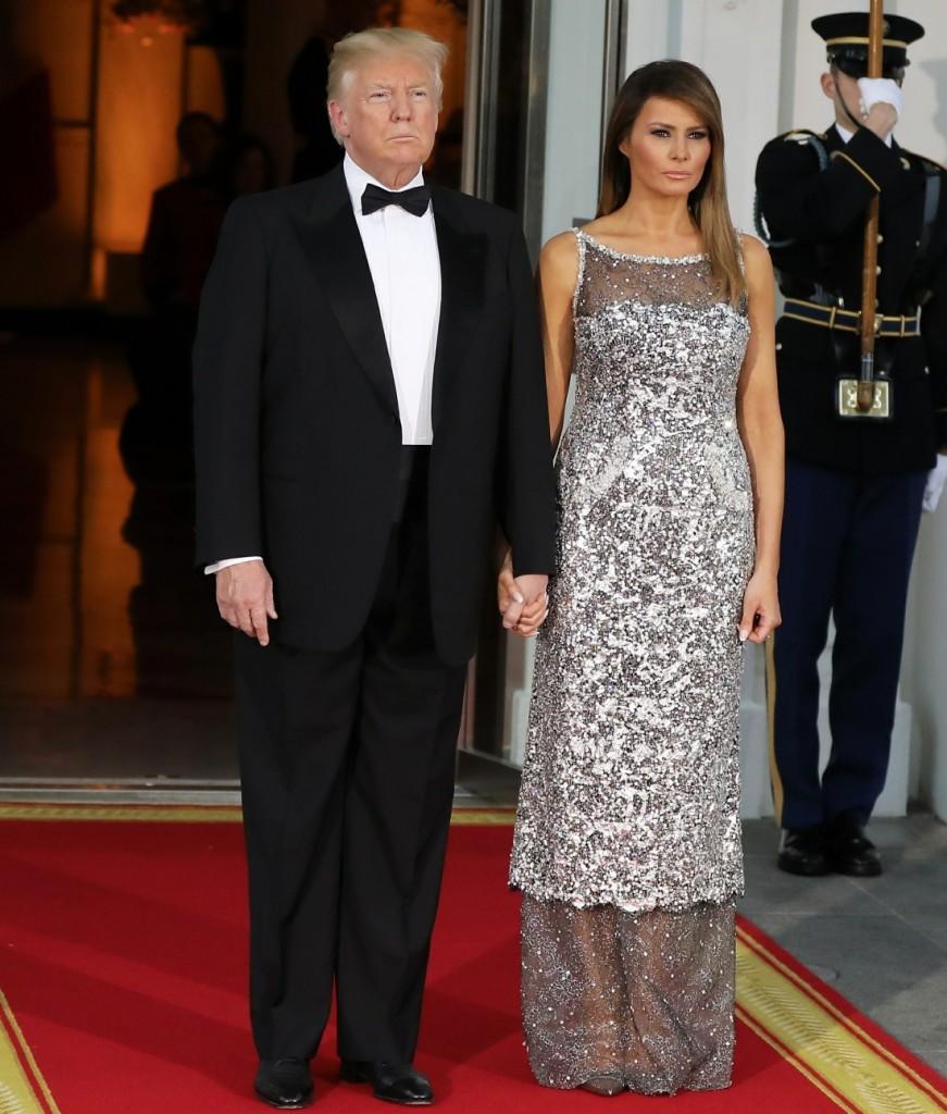 Donald Trump, Melania Trump, Emmanuel Macron, and Brigitte Macron attend a dinner at the White House