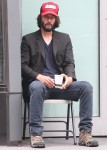 Keanu Reeves enjoys his morning smoking a cigarette while drinking coffee