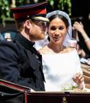 Newlyweds Prince Harry & Megan Markle travel down Windsor street after the Royal Wedding