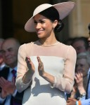 Meghan, Duchess of Sussex, attends a garden party at Buckingham Palace as part of the celebrations of the 70th birthday of the Prince of Wales