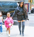 North West carries a unicorn stuffed toy as she gets back to the hotel with mom Kim Kardashian