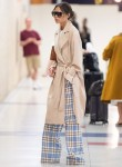 Victoria Beckham arrives at JFK airport looking fashionable as usual