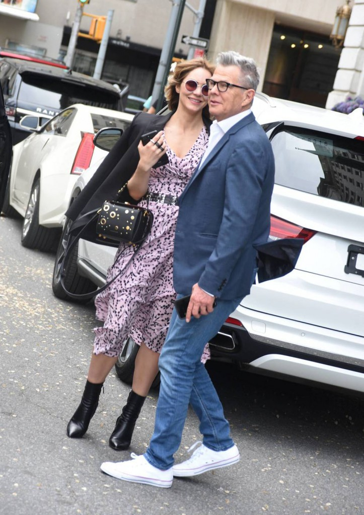 Katharine McPhee and David Foster wait for a ride on Central Park South