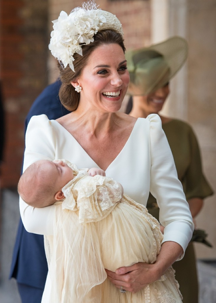 The Duchess of Cambridge carries Prince Louis as they arrive for his christening service at the Chapel Royal, St James's Palace, London
