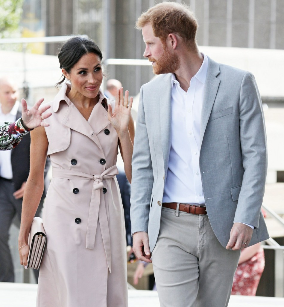 Meghan, Duchess of Sussex, wears a pale pink trench dress by House of Nonie as she visits the Nelson Mandela Centenary Exhibition at the Southbank Centre's Queen Elizabeth Hall in London with husband Prince Harry, Duke of Sussex