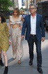 David Foster and Katharine McPhee hold hands as they arrive for dinner with Tina Fey