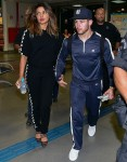 Priyanka Chopra and Nick Jonas draw a crowd of crazed fans arriving in Sao Paulo